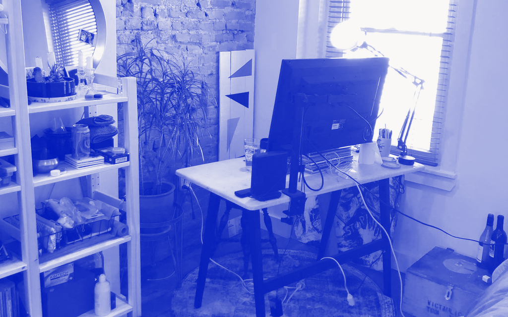 A photo of a home office reconfigured for a remote interview